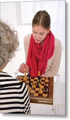 Women Playing Chess Metal Print