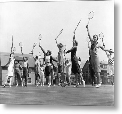Women Practicing Tennis Metal Print by Underwood Archives