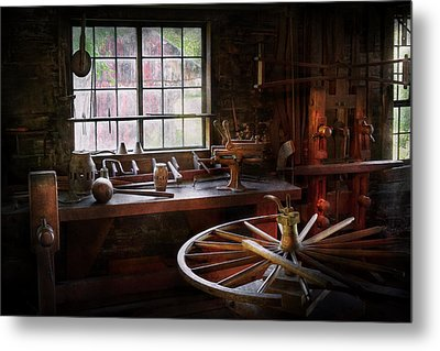 Woodworker - The Wheelwright Shop  Metal Print by Mike Savad