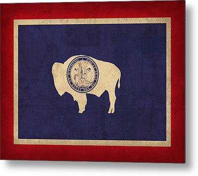 Wyoming State Flag Art On Worn Canvas Metal Print by Design Turnpike