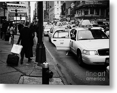 Yellow Cab On Taxi Rank Outside Madison Square Garden On 7th Avenue New York City Usa Metal Print by Joe Fox