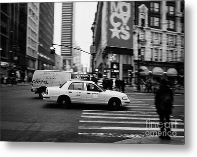 yellow cab taxi blurs past pedestrian waiting at crosswalk on Broadway outside macys new york usa Metal Print