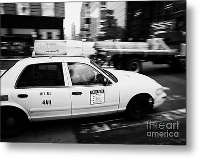 Yellow Cab With Advertising Hoarding Blurring Past Crosswalk And Pedestrians New York City Usa Metal Print by Joe Fox