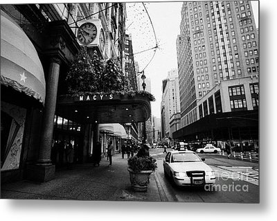 yellow taxi cab waits outside entrance to Macys department store on Broadway and 34th street Metal Print