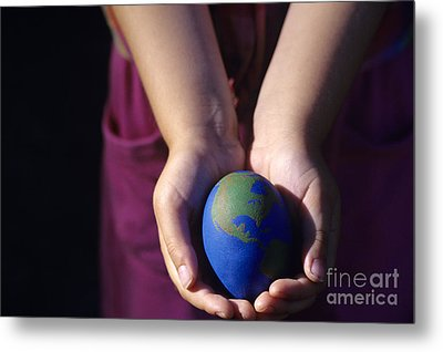 Young Girl Holding Earth Egg Metal Print by Jim Corwin
