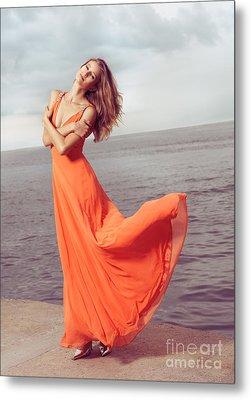 Young Woman In Orange Dress Flying In The Wind At Sea Shore Metal Print by Oleksiy Maksymenko