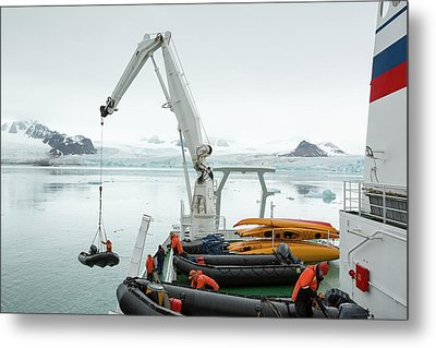 Zodiaks Being Lifted Into The Water Metal Print by Ashley Cooper