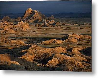 A Landscape Of Isolated Buttes And Rock Metal Print by Annie Griffiths