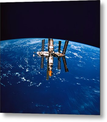 A Space Station In Orbit Above The Earth Metal Print by Stockbyte