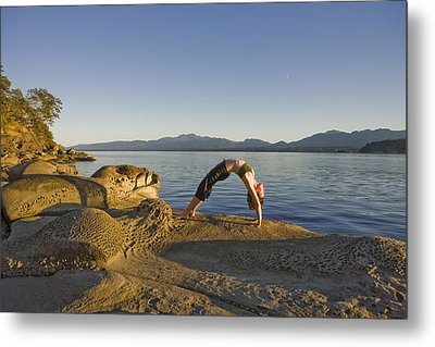 A Woman Does Yoga At Sunset Metal Print by Taylor S. Kennedy