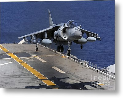 An Av-8b Harrier Jet Lands Metal Print by Stocktrek Images