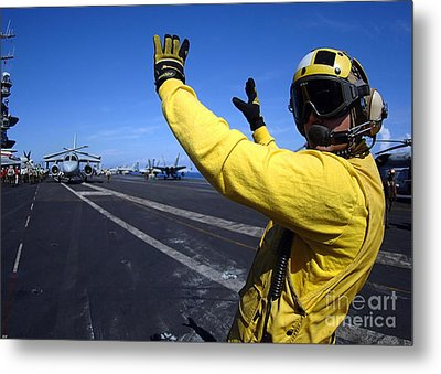 An Aviation Boatswains Mate Directs Metal Print by Stocktrek Images
