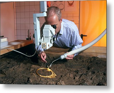 Archaeologist Cleaning A Golden Celtic Necklace Metal Print by Volker Steger