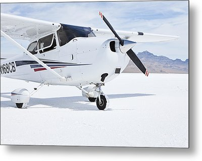Cessna Aircraft On Bonneville Salt Flats Metal Print by Paul Edmondson