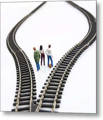 Figurines Between Two Tracks Leading Into Different Directions Symbolic Image For Making Decisions. Metal Print