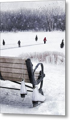 Ice Skates Hanging On Bench With People  Skating In Background Metal Print by Sandra Cunningham