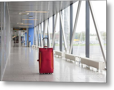 Rolling Luggage In An Airport Concourse Metal Print by Jaak Nilson