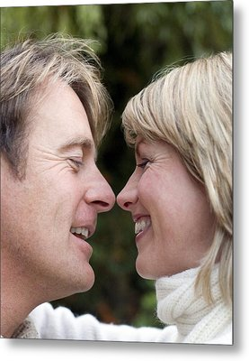 Smiling Couple Embracing Metal Print by Ian Boddy