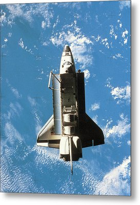 Space Shuttle Orbiting Above Earth Metal Print by Stockbyte