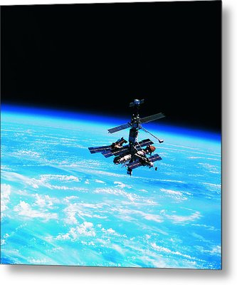 A Space Station Orbiting Above Earth Metal Print by Stockbyte