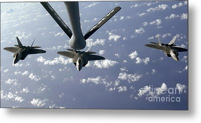A Three Ship Formation Of F-22 Raptors Metal Print by Stocktrek Images