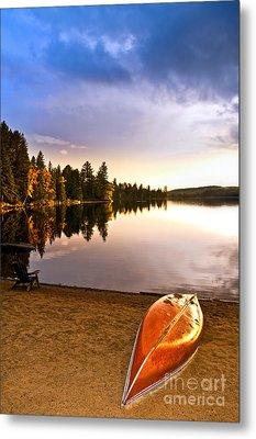 Lake Sunset With Canoe On Beach Metal Print by Elena Elisseeva