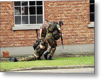 Soldiers Of The Belgian Army Helping Metal Print by Luc De Jaeger