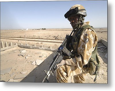 A British Army Soldier Provides Metal Print by Andrew Chittock