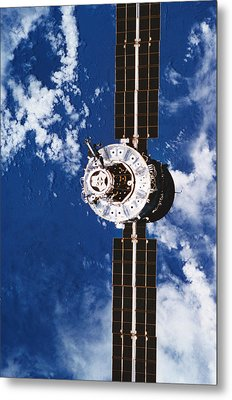 A Satellite Orbiting Above The Earth Metal Print by Stockbyte