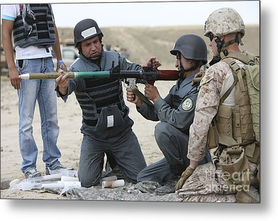An Afghan Police Student Loads A Rpg-7 Metal Print