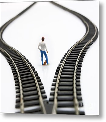 Figurine Between Two Tracks Leading Into Different Directions Symbolic Image For Making Decisions. Metal Print by Bernard Jaubert