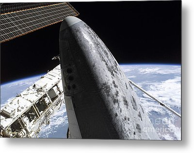 Space Shuttle Discovery Docked Metal Print by Stocktrek Images