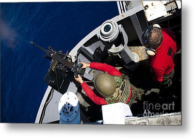 A Sailor Fires A .50-caliber Machine Metal Print by Stocktrek Images