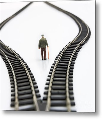 Figurine Between Two Tracks Leading Into Different Directions Symbolic Image For Making Decisions. Metal Print