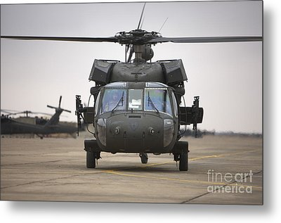 A Uh-60 Black Hawk Taxis Metal Print by Terry Moore
