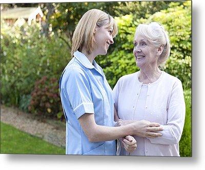 Nurse On A Home Visit Metal Print by
