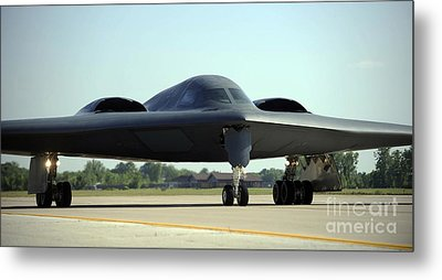 A B-2 Spirit Taxis Onto The Flightline Metal Print by Stocktrek Images