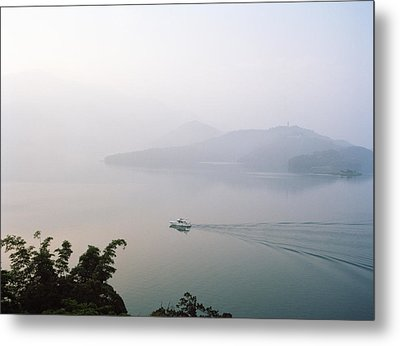 A Boat Cuts Into The Still Waters Metal Print by Justin Guariglia