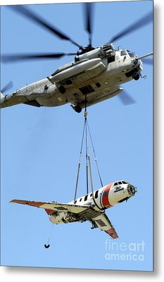 A Ch-53 Sea Stallion Lifts A Hu-25 Metal Print by Stocktrek Images
