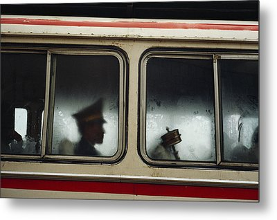 A Chinese Pla Soldier Sits On A Bus Metal Print