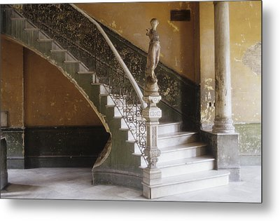 A Circular Marble Staircase And Statue Metal Print by Kenneth Ginn
