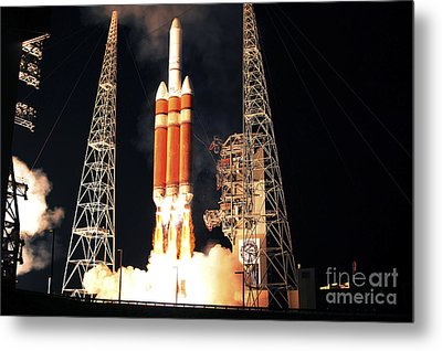 A Delta Iv Heavy Rocket Lifts Off Metal Print by Stocktrek Images