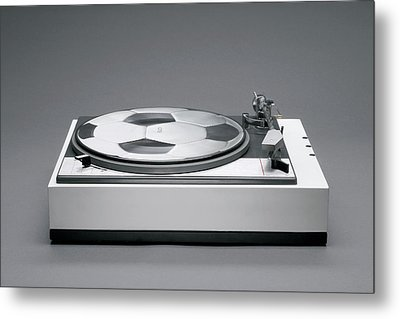 A Disk With A Soccer Print On A Record Player Metal Print by Benne Ochs