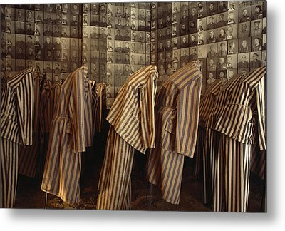 A Display Of Photographs And Uniforms Metal Print by James L. Stanfield