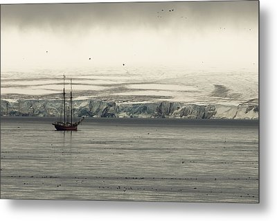 A Double-masted Sailboat Floats Near An Metal Print by Norbert Rosing