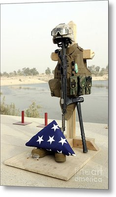 A Fallen Soldiers Gear Display Metal Print by Stocktrek Images