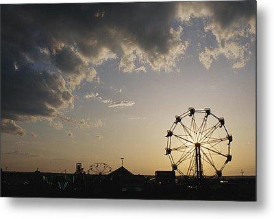 A Ferris Wheel Is Silhouetted Metal Print by Stephen Alvarez