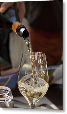 A Glass Of White Wine Being Poured Metal Print by Taylor S. Kennedy