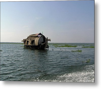 A Houseboat Moving Placidly Through A Coastal Lagoon In Alleppey Metal Print by Ashish Agarwal