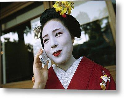 A Kimono-clad Geisha Talks On A Cell Metal Print by Justin Guariglia